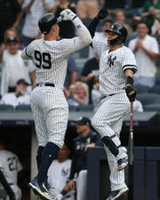 Jun 25, 2019; Bronx, NY, USA; New York Yankees right fielder Aaron Judge (99) celebrates his solo home run against the Toronto Blue Jays with catcher Gary Sanchez (24) during the first inning at Yankee Stadium. Mandatory Credit: Brad Penner-USA TODAY Sports