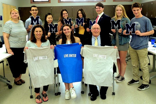 Millburn High School students awarded varsity letters in June for community service through a United Way of Northern New Jersey program. From left, front row are: Rose Twombly, United Way of Northern New Jersey; Nikki Levy (United Way Club president) and Principal William Miron. Back row: Lisa Galonardo, United Way of Northern New Jersey; Thaddeus Mahfouz; Celeste Choi; Caroline Most; Rachel Evenchick; Jamie Serruto; Rebecca McConnell and Jacob Becker.