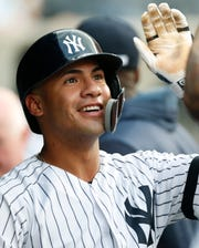 New York Yankees' Gleyber Torres reacts in the dugout after hitting a solo home run against the Toronto Blue Jays during the second inning of a baseball game Tuesday, June 25, 2019, in New York. (AP Photo/Kathy Willens)
