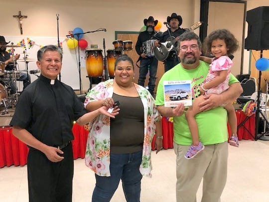 John Costilla was the winner of the 2019 Chevy Trax LT automobile that was raffled on Sunday, June 23rd during the 70th annual Fiesta de Santa Ana Catholic Church at 400 S. Ruby Street in Deming, NM. His ticket number was 1668 and he purchased the ticket Sunday afternoon. Pictured, from left, are Fr. Manuel F. Ibarra, Pastor. Joanna Costilla and husband John Costilla with daughter Natalie. For video of folklorico dancers, open this link: https://www.facebook.com/christine.milo.7/videos/10212373387363964/.