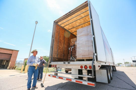 Ed Hultgren with Convoy of Hope unloads food and supplies at a former U.S. Army Reserve training center now housing asylum seekers near Valley and Brown roads on Wednesday, June 26, 2019.