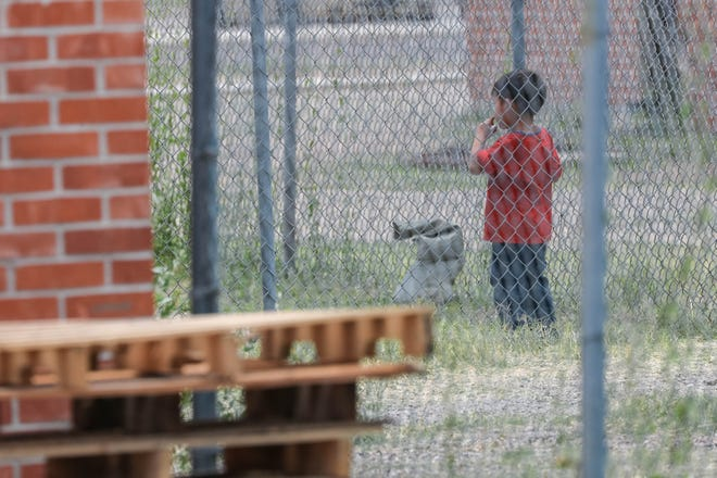 A child plays as Convoy of Hope unload food and supplies at a former U.S. Army Reserve training center now housing asylum seekers near Valley and Brown roads on Wednesday, June 26, 2019.