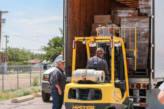 Convoy of Hope unload food and supplies at a former U.S. Army Reserve training center now housing asylum seekers near Valley and Brown roads on Wednesday, June 26, 2019.