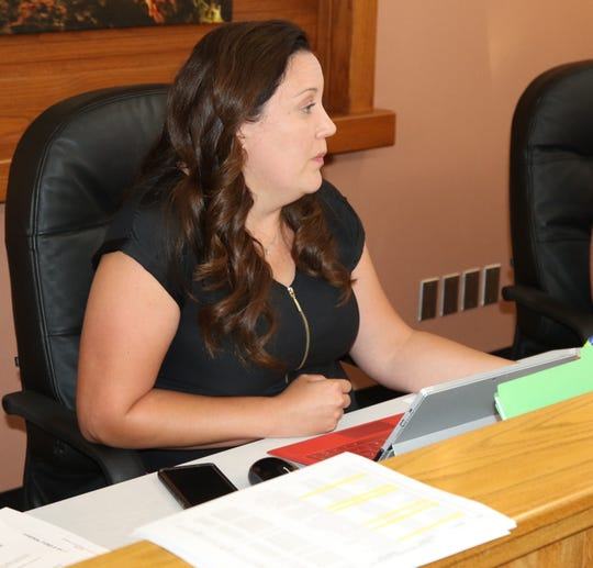 Roberta Smith, Eddy County interim co-county manager, addresses the Eddy County Board of Commissioners June 25.