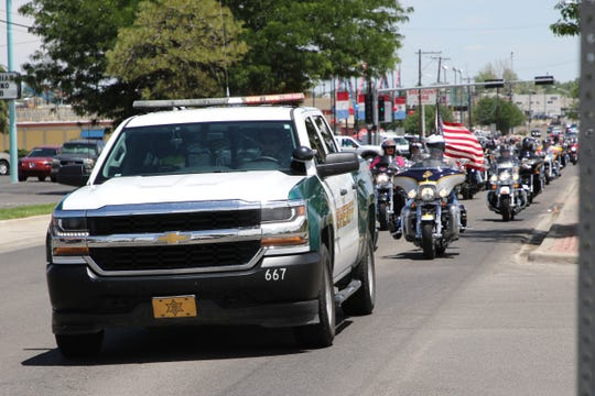 "A San Juan Country Sheriff's vehicle helps escort World War II veterans Hershel ""Woody"" Williams and Thomas H. Begay to the Farmington Museum on Wednesday."