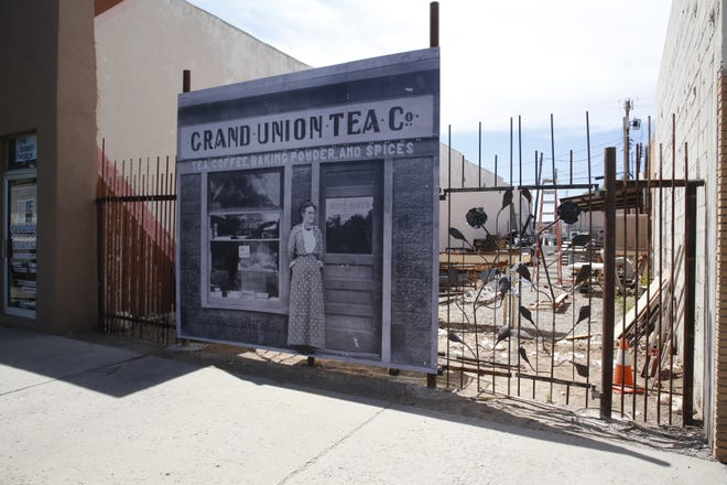 """A """"photo mural"""" featuring a downtown Farmington image from the early 1900s has been assembled in front of the space at 201 E. Main St."""