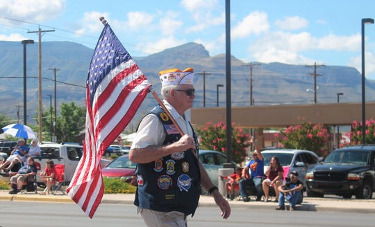 A local veteran walks the parade route during the Fourth of July celebration in Alamogordo, New Mexico.