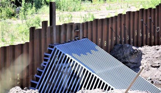 A smaller grate was installed after debris blocked the entrance to the diversion pipeline.