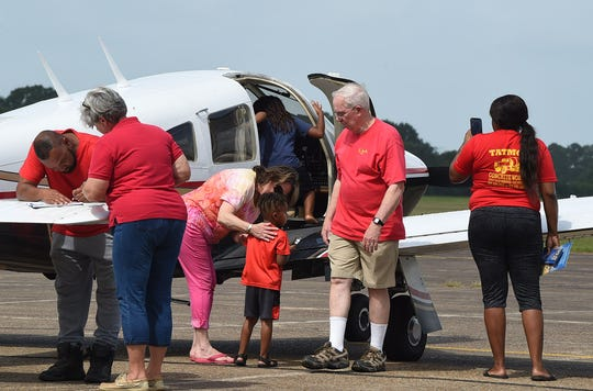 Aviation enthusiasts tour the St.Landry Parish Airport during Saturday's Fly-In event at the facility.