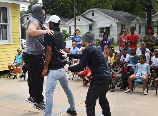 The Kubaki Dancers, from left, Terrance Morgan, Torrez Hypolite and Jude Romero dance an anti-bullying message to students at Hope for Opelousas. Also performing was the father-son trio of Joey Prados, Kyze Prados and Ze Prados, also known as the Itty Bitty Krew.