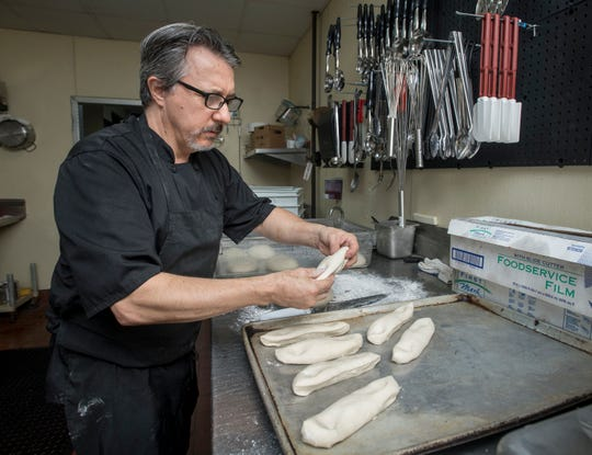 David Langevin, La Trattoria general manager and chef, prepares homemade bread at the restaurant in Pensacola in June.