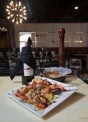 A dish of Frutti di Mare Parmiggiano is pictured at the new La Trattoria restaurant in Pensacola.