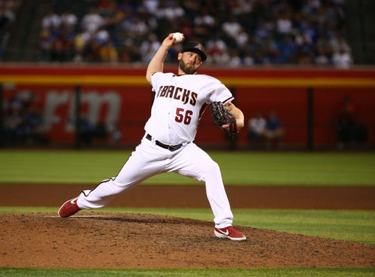 Diamondbacks closer Greg Holland picked up his 200th career save against the Dodgers on Monday.