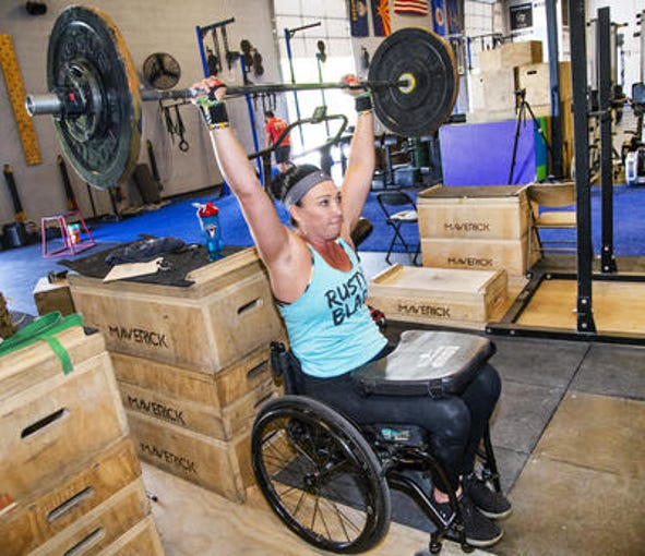 Six-time Olympic swimming medalist Amy Van Dyken-Rouen will be competing July 3-6 at the WheelWOD Games in Canada, an adaptive CrossFit competition.