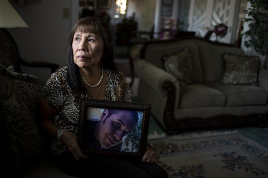 Patti Jones poses for a portrait with a picture of her nephew, Tony Lester, on Monday, June 17, 2019, in Mesa, Ariz. Jones has been an advocate for criminal justice reform since the Lester family filed a wrongful death lawsuit alleging officers stood by without giving first aid after Tony committed suicide in an Arizona correctional facility in 2010.