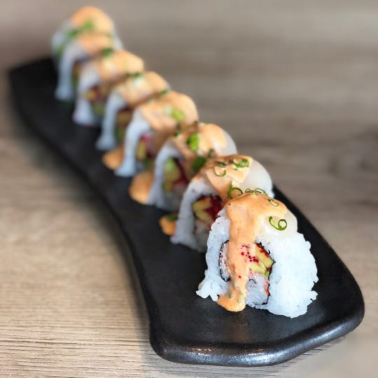 Karma Sushi in Flagstaff is featuring the Giant Leap roll as part of the celebration of Flagstaff's role in the moon landings. The roll has snow crab, tobiko, mango and avocado.