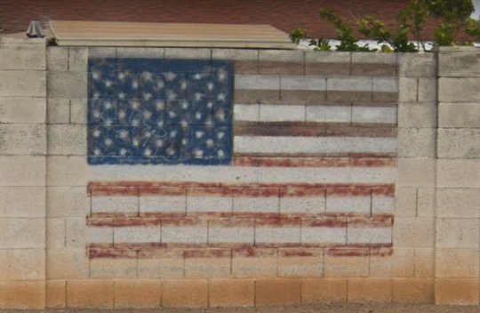 The mural, which is located west of 40th Street on Cactus Road, is shown here as it appeared before it was defaced.