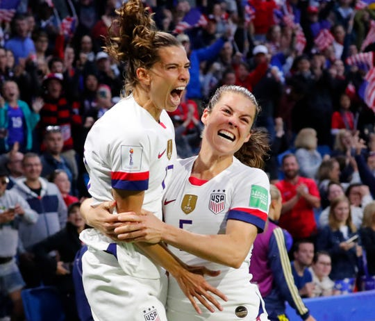 Jun 20, 2019; Le Havre, FRANCE; United States forward Tobin Heath (17) celebrates with defender Kelley O'Hara (5) after scoring a goal against Sweden during the second half in group stage play in the FIFA Women's World Cup France 2019 at Stade Oceane. Mandatory Credit: Michael Chow-USA TODAY Sports