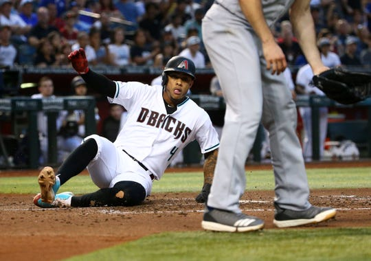 Arizona Diamondbacks Ketel Marte scores on an RBI-single by David Peralta against the Los Angeles Dodgers in the third inning on June 25, 2019 at Chase Field in Phoenix, Ariz.