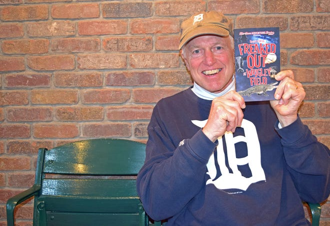 """Longtime Port Clinton tourist Roger D. Hess of Michigan holds his book, """"Freaked Out at Wrigley Field"""" which is set in Port Clinton."""