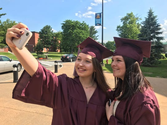 New Paltz High School graduates Kayleigh Rivers, left, and Lyndsay Wilson take a selfie prior to graduation on June 26, 2019.