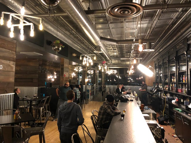"""In this behind-the-scenes photo, crew is setting up at The Rockfish Public House for a night of shooting the opening scene for """"The Special."""""""