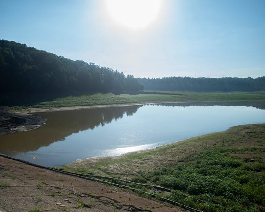 This is a view of Lake Williams on Wednesday, June 2019. The lake was drained beginning in summer 2018 in order to replace dam valves that dated back to the early 1900s. Once crews finishing pouring concrete Lake Williams will be refilled. The lake, which holds nearly 1 billion gallons of water when filled, straddles the borders of Springfield and York townships.