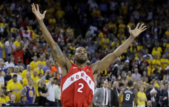 "Toronto Raptors forward Kawhi Leonard celebrates after the Raptors defeated the Golden State Warriors in Game 6 of basketball's NBA Finals in Oakland, Calif., Thursday, June 13, 2019. The growth of professional sports, like the NBA, has made life more difficult for owners of minor league teams, according to Salvatore ""Soccer Sam"" Fantauzzo."