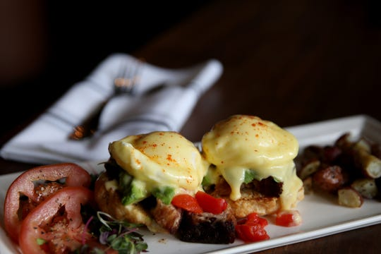 The Pork Belly Benedict at Whiskey Brown's Farmhouse Kitchen at the Salem Golf Club on June 25, 2019.