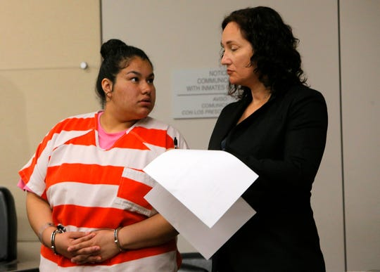 Michelle La Fuente looks at her attorney, Eden Schwartz, as Monterey County Superior Court Judge Andrew Liu orders her release from jail during Wednesday's hearing. She was ordered to stand trial on charges of child endangerment and assault causing death to a child at the same hearing.