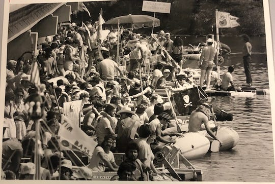Teams gather under the Bell Street Bridge in San Angelo preparing to compete in the fourth annual River Raft Race in 1984.