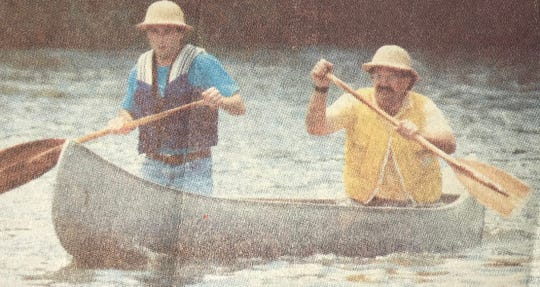 Jack Cowan and Rick Smith represent the San Angelo Standard-Times during the celebrity canoe race, part of the Concho River Rat Raft Race festivities in 1990.