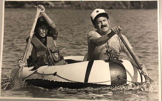 Joaquin Cervantes and Rosalinda Frias struggle toward the finish line during the inaugural Concho River Rat Raft Race held in San Angelo in 1980.