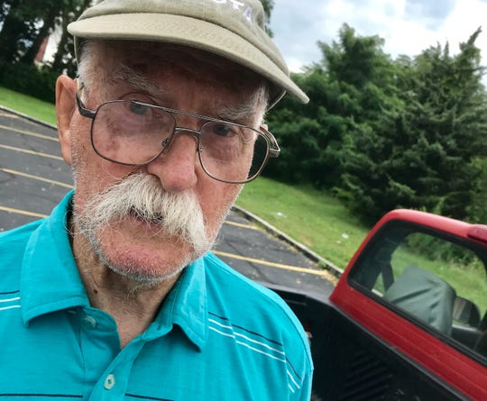Gene Baker, 91, says that Step One is to put the debris scattered about the Taylor's Drive-In parking lot into his pickup truck, which has 484,000 miles on it.