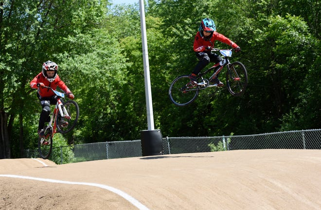 Jacob and Lucas Theisen get some hang time on their BMX bikes, Wednesday, June 26, 2019, at Pineview Park BMX Track. The brothers both qualified for the world championships in Belgium.
