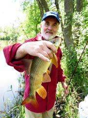 Staples resident Charlie Simkins enjoys riverbank fishing all summer long.