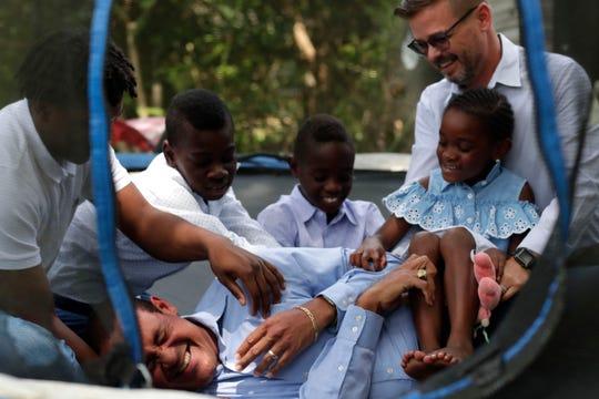 Casanova Nurse, front, gets tickled by his husband Daniel Nurse, their godson Kyron Kelley, 15, left, Cameron Nurse, 8, Neijal Nurse, 8, and Ava Rose Nurse, 5, Wednesday, June 26, 2019.