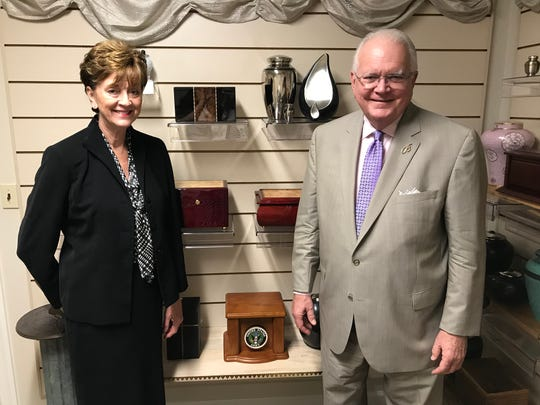 Susie Mozolic, left, and Rocky Bevis pose for a photo inside Bevis Funeral Home off John Knox Road, July 2019.