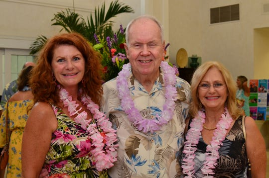Karen Deigl, left, with Robin and Brenda Lloyd at TheYouth Guidance42nd annual Tropical Night Luau at Oak Harbor.