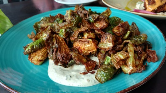 Sprouts-lovers will swoon over The Edgewood Eatery's crispy Brussels sprouts with Tzatziki sauce.