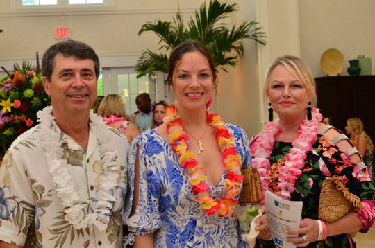 Eric Menger, left, Victoria Kerkeck and  Connie Foster at TheYouth Guidance42nd annual Tropical Night Luau at Oak Harbor.