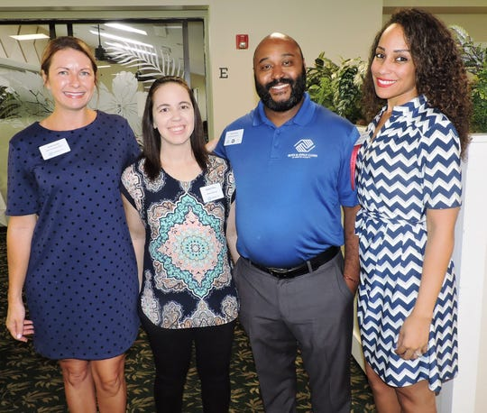 Sarah Torres, left, Jackie Price, Omar Ferrera and MaccaEna Liacos at Stuart/Martin County Chamber of Commerce Luncheon to announce partnership between Boys & Girls Clubs of Martin County and the Martin County School District.