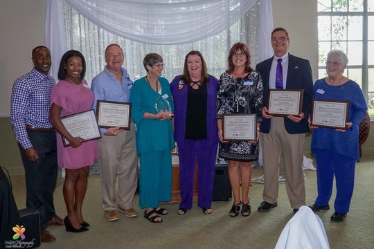 The 2019 Safe Space Volunteers of the Year, from left,  Ray and Natalie Desmangles, Hamp Elliott, Joan Smith, SafeSpace CEO Jill Borowicz, Nancy Ingram, David Thompson and Carol Stone.