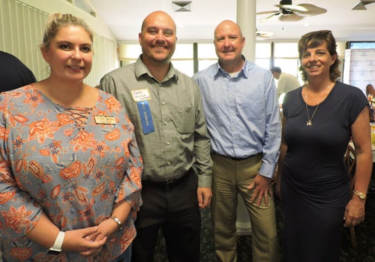 Tara Biek, left, Peter Sicoli, Mike Readling and Kate Harper at the Stuart/Martin County Chamber of Commerce Luncheon to announce partnership between Boys & Girls Clubs of Martin County and the Martin County School District.