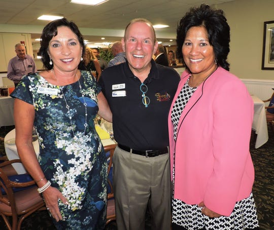 Lisa Baxter, left, Mark Sandler and Carol Houwaart-Diez at Stuart/Martin County Chamber of Commerce Luncheon to announce partnership between Boys & Girls Clubs of Martin County and the Martin County School District.