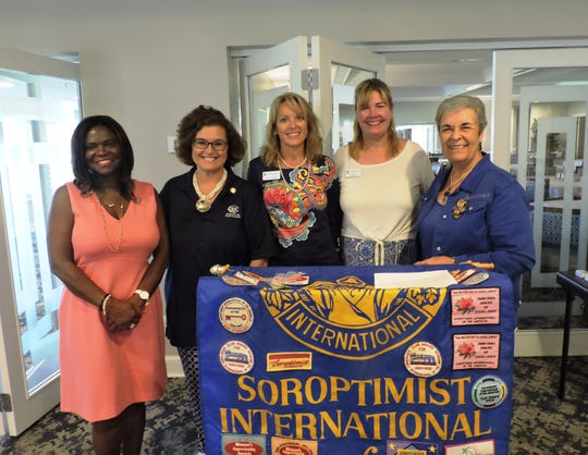 Lorna Moodie, left, Mary Ann Searle, Marney McKee, Jill Keegan and Marie Kennedy at Soroptimist International of Stuart's Installation of Officers and Annual Retreat.