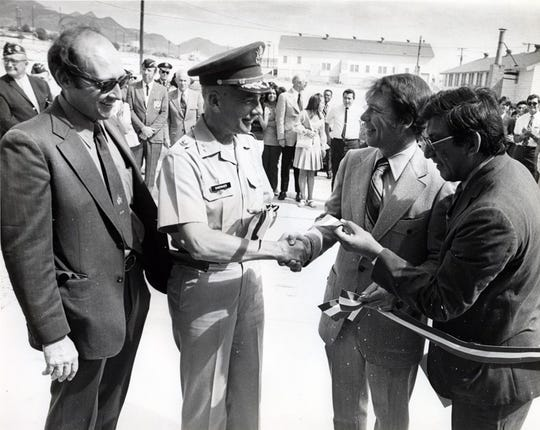 In this Aug. 24, 1972, photo, El Paso Community College held its formal opening on a Wednesday of its new campus located in the Logan Heights area of Fort Bliss. From left, following the ribbon cutting, are Dr. Thomas Hatfield, of the Coordinating Board of the Texas College and University System; Maj. Gen. Raymond L. Shoemaker, Fort Bliss commanding general; Joe Foster, chairman of the college board, and Dr. Alfredo de los Santos, college president.
