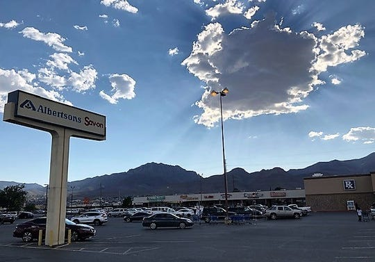 The Albertsons supermarket at 9111 Dyer St., and Hondo Pass Drive, in Northeast El Paso, is located between two shopping centers, including an old one pictured here, left, that has a Dollar Tree and other stores.