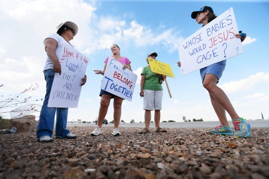 "Julie Lythcott-Haims, from left, Kris Brockmann, Peggy Hinkle and Jennifer Lang gathered in front of he Border Patrol station on Hondo Pass Drive to protest Tuesday, June 25, in Northeast El Paso. Julie, Kris and Jennifer said they were inspired to come to El Paso and protest after the New York Times ran an article about the conditions of the border patrol holding facilities. Peggy is an El Paso native who met up with the ""Caravan 2 Clint"" group to help out."