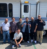 """Cristian Valadez and his co-workers at Toppers Pizza pose in front of his trailer on the set of """"Jimmy Kimmel Live!"""" before his June 18 appearance on the late-night show in Hollywood."""